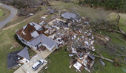 Debris litters a property after a home was damaged by a tornado a day earlier in Beauregard, Ala., Monday, March 4, 2019.