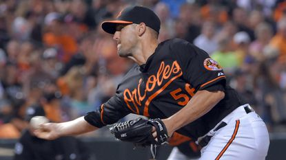 Baltimore Orioles relief pitcher Darren O'Day pitches against the Cleveland Indians at Oriole Park at Camden Yards.