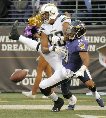 Ravens defensive back Anthony Levine, right, is called for pass interference on the San Diego Chargers' Malcom Floyd in the fourth quarter.
