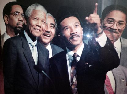 Congressmen Kweisi Mfume (right) meets with Nelson Mandela on his first trip to the US after his inauguration.