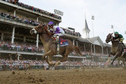 Mario Gutierrez crosses the finish line atop I'll Have Another to win the 138th running of the Kentucky Derby.