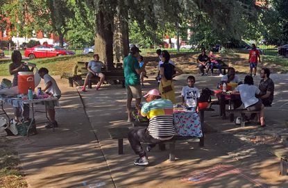 Residents of the neighborhoods along both sides of Eutaw Place gathered for a pop-up playdate earlier this month. That street divided red-lined Baltimore during the days of segregation.