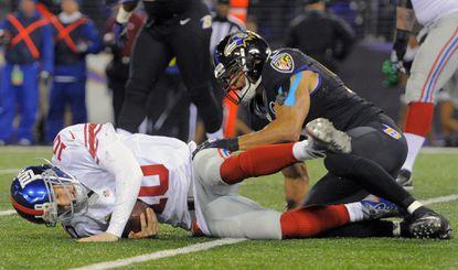 Ravens linebacker Brendon Ayanbadejo, right, sacks New York Giants quarterback Eli Manning in the second quarter.