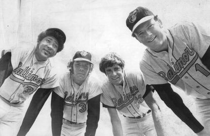 From left, Mike Cuellar, Pat Dobson, Jim Palmer and Dave McNally, all 20-game winners, huddle at Orioles spring training in Miami. (March 1972)