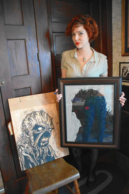 """Jessi Hardesty is pictured with her reductive woodcut block and print titled """"Verdant Dominion (Swamp Thing)."""" It was created for an invitational portfolio called """"Nature's Grasp"""" hosted by Lee Arts Center in Virginia."""