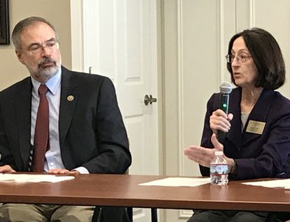 U.S. Rep. Andy Harris, left, visited Brightview Avondell in Bel Air South Wednesday to discuss recent developments in research and treatment of Alzheimer's Disease. Harris listens as Cass Naugle, executive director of the Alzheimer's Association's Greater Maryland chapter, speaks.