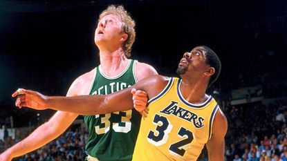 The iconic photo of Larry Bird and Magic Johnson battling for rebounding position during the 1984 NBA Finals.