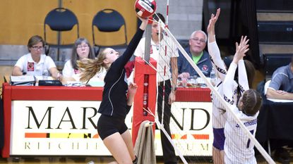 Western Tech's Emily Badin tries to put a shot past Smithsburg's block attempt during a Class 1A state semifinal volleyball match at University of Maryland's Ritchie Coliseum on Wednesday, Nov. 15.