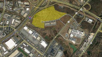 Atapco and Chesapeake Real Estate Group LLC say they will likely build warehouses for retailers on a parcel of land in White Marsh.