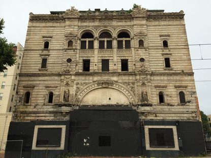 The facade of the Mayfair Theatre on Howard Street. The theater is set to be redeveloped by local design and construction firm Zahlco.