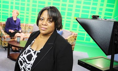 Mary Weeks, producer of the award-winning Columbia Association television show Columbia Matters, poses for a picture in the television studio at Howard Community College.