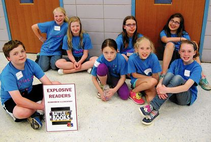 One of the teams from Runnymede Elementary that competed in the 2014 Battle of the Books competition is shown.