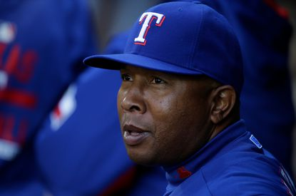 Rangers third base coach Tony Beasley stands in the dugout before a baseball game against the Seattle Mariners, Saturday, April 18, 2015, in Seattle.