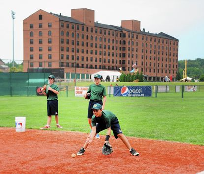 Members of Team Australia, in town for the Cal Ripken Babe Ruth Baseball World Series, practice at the Ripken Baseball complex in Aberdeen Wednesday near the Courtyard by Marriott Hotel. The hotel's liquor license was suspended temporarily because of a resident licensee issue with the Harford County Liquor Control Board.