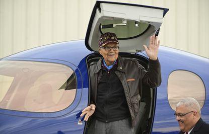 Retired U.S. Air Force Col. Charles McGee, a Tuskegee Airman and a decorated veteran of three wars, waves after landing in a Cirrus SF50 Vision Jet to help celebrate his 100th birthday at Frederick Municipal Airport on Dec. 6, 2019.
