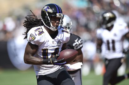 Ravens wide receiver Marlon Brown catches a pass in the first quarter against the Oakland Raiders at Oakland-Alameda County Coliseum.