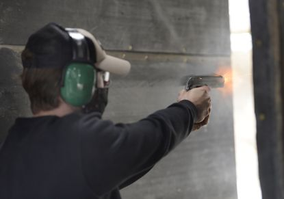 Owen Bailey of Laurel shoots a .40 caliber pistol at the Hap Baker firearms facility in Westminster Wednesday, April 14, 2021. The range has been closed since January 10 while undergoing renovations. The facility, located behind the Carroll County Northern Landfill, features a 200 yard rifle range as well as a 25-yard pistol range.