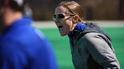 Maryland women's lacrosse coach Cathy Reese shouts instructions during a game against James Madison at the Field Hockey & Lacrosse Complex on March 24, 2018.