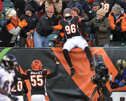Cincinnati's Carlos Dunlap celebrates with the Paul Brown Stadium crowd after intercepting a pass from Tyrod Taylor and running it back for a touchdown in a 23-17 win last season over the Ravens.