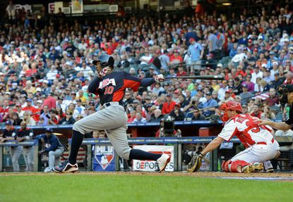 Orioles CF Adam Jones hits a two-run double in the 8th in Team USA's 9-4 win over Canada in the World Baseball Classic.