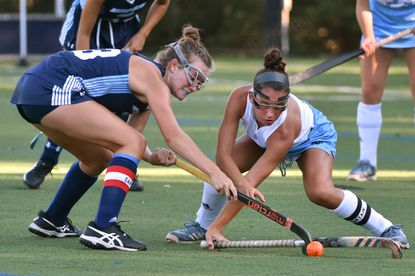 Notre Dame Prep's Jenna Klaers, left, and Garrison Forest's Ryleigh McComas try to direct the ball in second-period action. Top-ranked Garrison Forest beat No. 4 Notre Dame Prep in overtime, 2-1, at Garrison Forest.