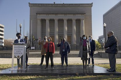 Baltimore mayor Brandon Scott administers the oath of office to new council members during the inauguration in front of War Memorial Plaza Thu., Dec. 10, 2020. (Karl Merton Ferron/Baltimore Sun Staff)