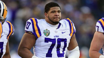 Louisiana State offensive tackle La'el Collins will meet with the Ravens at the NFL's scouting combine in Indianapolis.