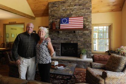 Jean and Mike Tumbarello stand in the great room of their dream home near Deep Creek Lake.