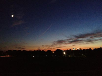 The sun sets over Baltimore for the second-to-last time in summer 2012, as seen from Patterson Park on Sept. 20.