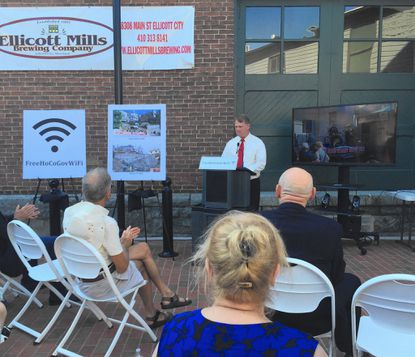 Howard County Executive Allan Kittleman announces the launch of free WiFi for historic Ellicott City on July 20, 2015.