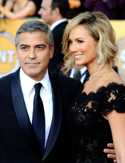 Baltimore's Stacy Keibler (right) and George Clooney got food poisoning in Italy.