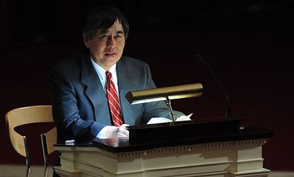 University of Maryland at College Park President Wallace Loh speaks to students at a vigil held following a murder-suicide at an off-campus apartment.