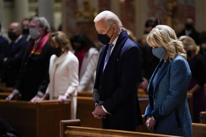 FILE - In this Wednesday, Jan. 20, 2021 file photo, President-elect Joe Biden and his wife, Jill Biden, attend Mass at the Cathedral of St. Matthew the Apostle during Inauguration Day ceremonies in Washington. The U.S. Conference of Catholic Bishops voed at their annual spring meeting to create guidelines on who can take communion. (AP Photo/Evan Vucci, File)