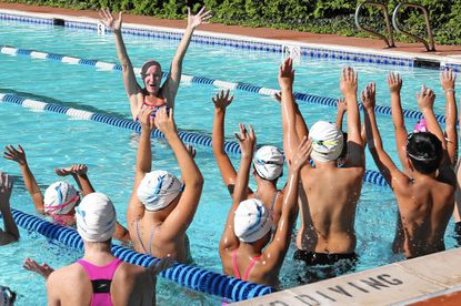 Olympic gold medalist Staciana Stitts Winfield ends a swimming clinic with a cheer at the Bel Air Athletic Club on Saturday.