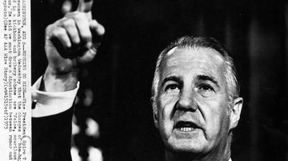 """In this 1973 file photo, Vice President Spiro T. Agnew tells newsmen in Washington Wednesday that the charges of him being involved in a kickback and bribery scheme are """"false, scurrilous and malicious."""" He said we must draw a distinction between rumor and fact."""