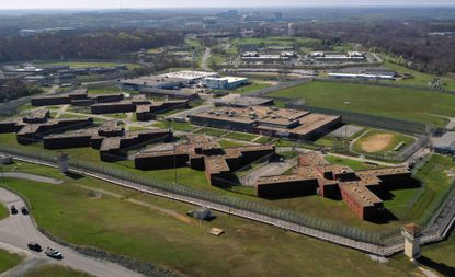 Thousands of Maryland state workers, including officers at the Jessup Correctional Institution, pictured, will receive a temporary pay increase for at least another month. The AFSCME union argues such workers should receive double pay.