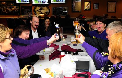 "Harford County Ravens Nest #1 ""travel team"" gives a toast after finalizing plans for the road trip to New Orleans later this week."