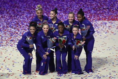 Ashton Locklear, clockwise from top left, Aly Raisman, Madison Kocian, GabrielleDouglas, Ragan Smith, Simone Biles, MyKayla Skinner and Lauren Hernandez pose for photos after competing in the U.S. Olympic gymnastics trials.