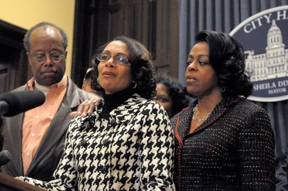 "Surrounded by members of her staff, Baltimore Mayor Sheila Dixon announces that she will resign, part of a plea deal that brought a years-long corruption investigation to a close and ended the tenure of the city's first female mayor. Dixon left office Feb. 4, the day she was sentenced both for a guilty plea she entered in a perjury case and for her embezzlement conviction in December 2009. She kept her $83,000 pension, and her criminal record will be wiped clean if she completes the terms of her probation within four years. A teary Dixon returned to City Hall to announce her resignation, saying that she was doing so ""with deep regret and sadness."" She did not apologize but said there would come a time, after sentencing, that she could give her full side of the story. ""I love the city. I love the people of this city,"" said Dixon, who was raised in West Baltimore, where she still lives. ""Now it's time to move on."""