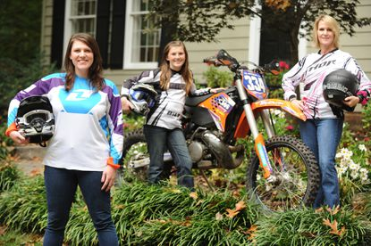 Three generations of dirt-bike racers: Amanda M. Knapp, left, at her home in Columbia with her daughter, Priscilla G. Knapp, 11, and her mother, Priscilla R. Thompson.