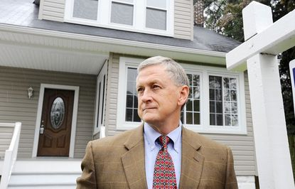 Real estate agent Rusty Miller pictured outside a home on Kolb Avenue that was listed by a scammer as a rental property, when Miller was the listing agent to sell the home.