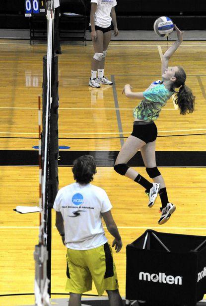 Rachel Horton spikes the ball during vollyball camp at Stevenson University on Monday.