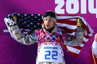 Sage Kotsenburg celebrates after winning the gold medal in the men's snowboard slopestyle on Saturday at Rosa Khutor Extreme Park.