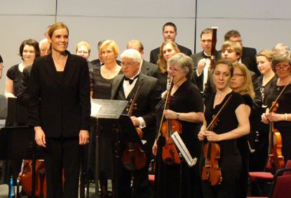 """AACC Symphony Orchestra music director and conductorAnna Bnneweg, left, at the conclusion of """"Russian Easter Celebration."""""""