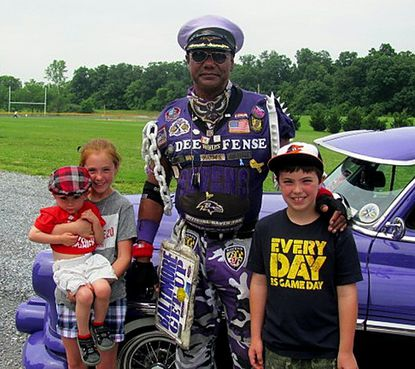 Pictured at the benefit car show are, from left: Grace Noone, holding brother Cooper Noone, Captain Dee Fense and Parker Noone. The Noone children are from Westminster.
