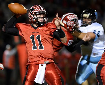 North Carroll quarterback Jack Flowers looks to pass against Westminster.