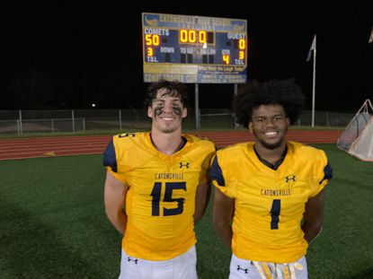 Catonsville senior James Azbill, left, and Jayvon Brown were all smiles after the Comets' 50-0 win over Dulaney. Azbill had an interception and fumble recovery and Brown returned a kickoff for a touchdown.