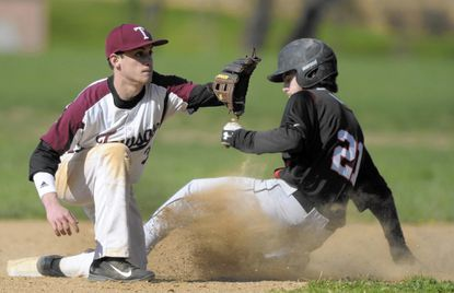 Dulaney's Tyler Pillas, right, slides safely into second base as Towson second baseman John Davis covers in the third inning of a high school baseball game.