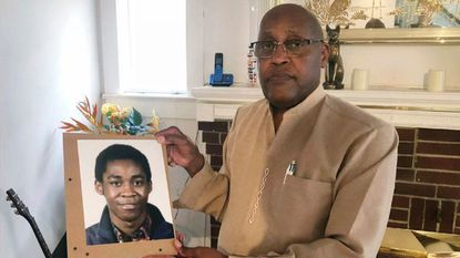 In this Sept. 5, 2018, file photo, Dia Khafra, father of Askia Khafra, holds a photo of his son in his Silver Spring home.