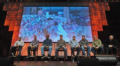 Orioles manager Buck Showalter, right, and his staff field questions at Fanfest at Baltimore Convention Center.